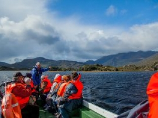 Travelling along Killarney's Upper Lake with the McGillycuddy Reeks in the background
